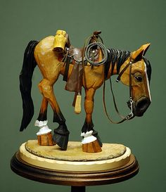 This is a favorite from the many carvings from Lynn Doughty. His site is at: http://outwestwoodcarving.blogspot.com/