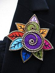 She creates wonders with a bit of recycled felted sweaters and zippers.