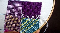 Tied cross stitches on a woven chequerboard ground.