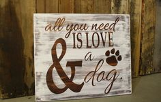 "Wooden ""All you need is love and a dog"" rustic white washed sign."