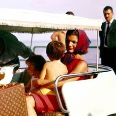 I want to be as chic a mom as Jackie O. I also want the LV luggage