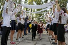 First graders take part in a ceremony to mark the start of another school year in Kiev, Ukraine, September 1, 2015. REUTERS/Gleb Garanich