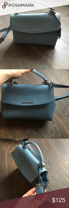 Michael Kors purse. LIKE NEW Small crossbody. Color is similar to a periwinkle blue. Only used twice! Just bought it and I love it! Need to pay some medical bills so the purse has to go. Michael Kors Bags Crossbody Bags