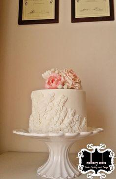 White embossed wedding cake, single tier with sugar flowers - www.malberrycakes.co.za