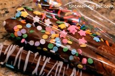 Chocolate Dipped Pretzel Rods rolled in sprinkles.. a Great Valentine's Day Treat!