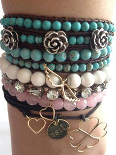 june 13,2012 : black leather with three different hand made golden charm bracelet, pink quarts with gold heart charm bracelet and white jade with gold angel wings charm bracelet from my summer gold collection; vintage swarovski bracelet; turquoise with silver flowers wrap bracelet from my 2009-2010 winter and summer collection
