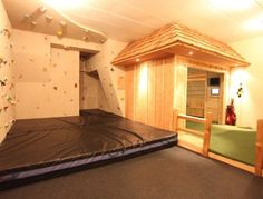 Kids play room SO CUTE u can use it as a gymnastic room and it has a super cute rock wall !