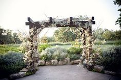 Baby's breath and sticks are an easy (and inexpensive) add-on to a ceremony site!