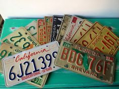 VIntage license plates from CA, the old black and yellow ones, would be awesome as center pieces or even decoration and would include matty bob! any old license plate, these are for $50 on etsy, for 13 of them, but we can scour the antique stores in the orange circle for some.