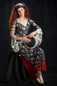 Costumed beauty playing mid-east belly dance rhythms on her hand drum. a metal darbuka - doumbek goblet drum. Drum Lessons, Guitar Lessons, Drums For Sale, Hand Drum, Belly Dance Costumes, How To Treat Acne, Best Vibrators, Radiant Skin, Belly Dancers