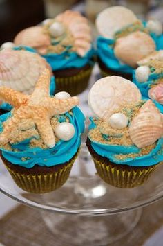 Glam Candies: {Sail Away With Me} Nautical Dessert Bar Cupcakes. Do not know when I would really need to make something like this until Emily is older but they are so neat! Seashell Cupcakes, Sea Cupcakes, Yummy Cupcakes, Cupcake Cookies, Cupcake Pics, Decorated Cupcakes, Pretty Cupcakes, Themed Cupcakes, Cupcake Ideas
