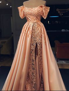 This Valdrin Sahiti gown is similar to a Charles James ball gown from 1948. Both dresses have a sweetheart neckline and a fit and flare silhouette. Both dress have a cape like look to the bottom that is two tone. The Valdrin dress is extremely detailed whereas the Charles James gown has no embellishments and is pretty basic. Yeburzing M. 2/15