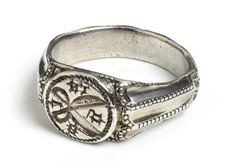 """Silver Ring, circa 1475-1525. """"The open shears engraved upon the bezel of this signet ring indicate that it belonged to a member of a tailor's guild. The tools of craftsmen were often engraved upon seal matrices and signet rings to indicate membership of the guild and thus to confer status upon the wearer. A large group of similar rings from Germany and central Europe have been found, most of which are silver or bronze, and which bear the emblems of a number of different trades."""""""