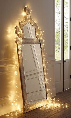 Adorn your mirror with delicate string lights for a wow-worthy display.