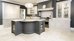 This sleek painted kitchen is a contemporary twist on a traditional shaker style featuring bespoke cabinetry and dark oak kitchen dresser. Kitchen Larder Cupboard, Kitchen Dresser, Shaker Kitchen, Kitchen Cabinets, Custom Kitchens, Luxury Kitchens, Home Kitchens, Kitchen Interior, Kitchen Decor