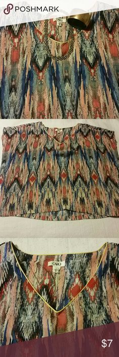Multi colored v neck sheer blouse Multi colored sheer v neck blouse with gold color around the v neck Cato Tops Blouses