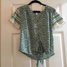 """Button down shirt Gorgeous detailing top! Green, blue, & white coloring with designs! This is mine! I used to love this shirt and would wear it a lot but now not so much! The brand on the tag says """"Blue Rain"""", but when I try to put that as the brand name it doesn't work so the brand name will be something else to just get the item seen! No trades Urban Outfitters Tops Button Down Shirts"""