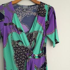 Short sleeve purple and teal dress Pretty pattern with buckle at waist. V neck. NWOT. Dresses