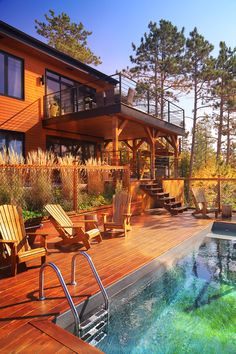 Colorful Stylish House with Pool in the Woods Wood Images, Us Images, Royalty Free Pictures, Royalty Free Stock Photos, Pixel Image, Image Categories, Picture On Wood, Daily Photo, Pool Houses