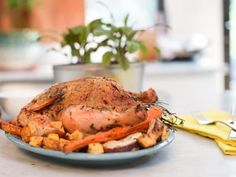 Get Herb-Roasted Chicken with Root Vegetables Recipe from Food Network