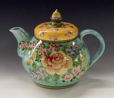 Handmade ceramic teapot.  Thrown on a potters wheels and hand painted.  www.sandykreyer.etsy.com