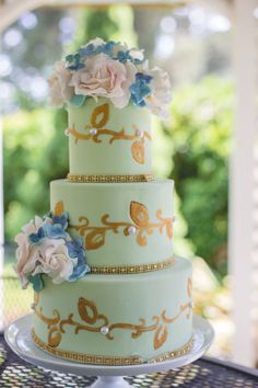 "Vintage Wedding Cake  A vintage themed mint green wedding cake with hand painted gold ""leaf filigree"" and romantic sugar florals."