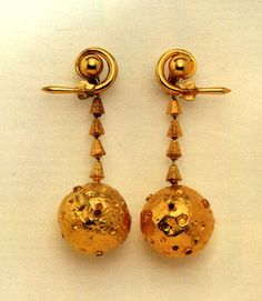 """Jackie's """"moon earrings"""" are 18k gold, made by Ilias Lalaounis of Greece in 1969. The auction estimate for these was $1000-1200, but the hammer price was $112,500."""
