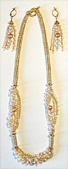 """Triangle Beads, Herringbone & Pearls Pattern. What a nice surprise to find that triangle beads create such a richly textured, slinky yet solid feeling beaded chain. The """"Links"""" are slightly larger & make a stronger statement than Delica beads. The camel and cream pearl combination shown is a classic especially nice with Spring, Summer, and Fall fashions."""