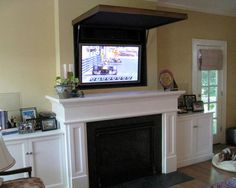 Hiding a Flat Panel TV Above a Fireplace - traditional - living room - orange county - TVCoverups Living Room Orange, Living Room Tv, Interior Design Living Room, Home And Living, Hide Tv Over Fireplace, Above Fireplace Ideas, Porch Fireplace, Faux Fireplace, Fireplace Mantels