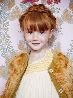 Love everything about her :hair, freckles, and of course her gorgeous faux fur cardie and beautiful smocked dress!
