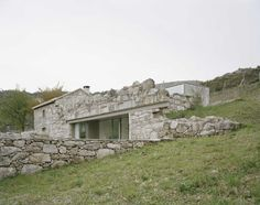 House in Melgaço by Brandao Costa Arquitectos An extension to a small rural stone building, with additions of a lounge and three bedrooms, constructed of local materials.
