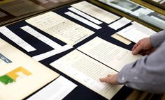 """Archivists care for records of great Hollywood directors. A case is installed for the exhibition """"100 Years of Orson Welles: Master of Stage, Sound and Screen."""" Photo by Chaz Mottinger"""