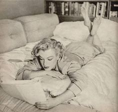 Marilyn, taken at home in The Beverly Carlton, April, 1952 by Andre De Dienes.