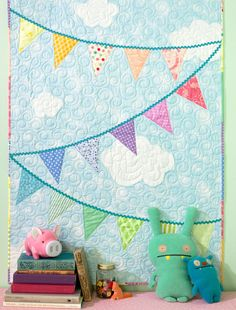 Bunting applique makes this quilt so playful and festive! Perfect for a baby quilt. From Everyday Handmade.