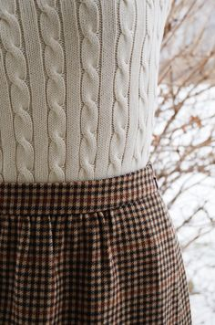 cream cable knit sweater with the perfect brown gingham skirt