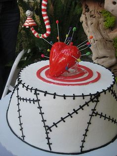 Tim Burton theme cake... Life isn't easy  for the Pin Cushion Queen. When she sits alone on her throne, pins push through her spleen.