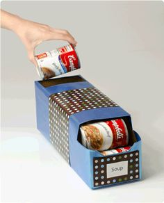 Great Upcycle/repurpose! Use soft drink case to store canned food.