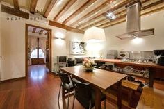 Ferran is a spacious apartment in Barcelona that offers three large, tastefully designed bedrooms facing a sunny terrace, 3 bathrooms and a large living area. Barcelona Apartment, Color Beige, Open Floor, Apartment Therapy, Living Area, Habitats, Beautiful Homes, Sweet Home, Dining Table