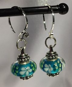 Sweet blue Murano lampwork beads used on a bead-holding fixture. The lampwork beads can be changed out for whatever colors suit your outfit or mood. Shop our individual beads.