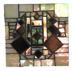 Light switch in art deco style mosaic. Hand crafted in Murano and Tiffany stained glass. Please feel free to send me a message on Pinterest for commissions.