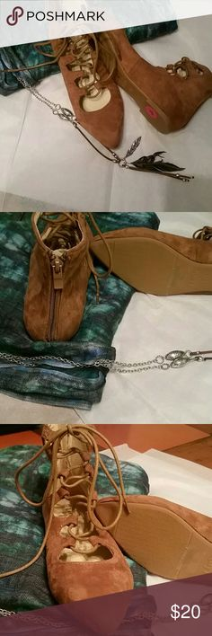 Lace up sandals Tan lace up sandal  with zip up back heel nwot size 4. Shoes Sandals