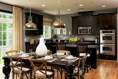 Love everything about this kitchen area, especially how well the various shades of brown work with each other.