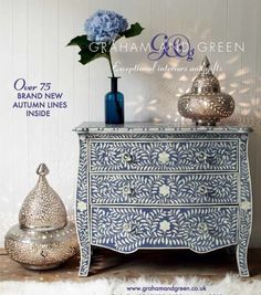 Love is a blue hydrangea, pretty Moroccan lanterns and an indigo bone-inlay dresser. from the autumn collection, Graham and Green, UK.