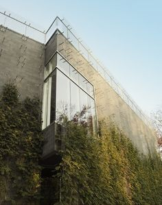 steel mesh screen built onto the exterior will eventually camouflage this building in the woods.