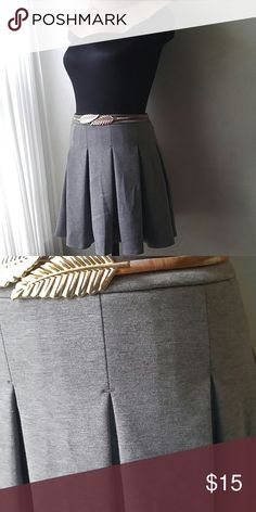 Cute & Flirty pleated skirt New never worn. Adorable little skirt. 15.75 waist,.18 inches in length. Lightweight neoprene adds structure and swing to this cutie. Pair with boots and a moto jacket and you're ready to roll. Don't miss out. Merona Skirts Mini