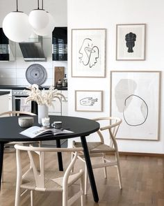 Art wall in the home of @hejmelig #theposterclub #theposterclubcollection #Regram via @theposterclub Stunning art in the kitchen. Art wall with minimal prints from Copenhagen based The Poster Club. #scandinavianliving #artprints #artwall #picturewallidea #mininal
