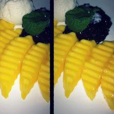 Black sticky rice with mango served with coconut milk ice cream..