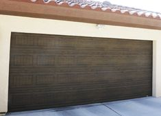 Woodgrain garage door finish simulates the beauty of wood, while contributing to the appeal of the home. Martin Garage Doors, Garage Doors For Sale, Garage Door Colors, Commercial Garage Doors, Automatic Gate, Wood Grain, Outdoor Decor, Beauty, Home Decor