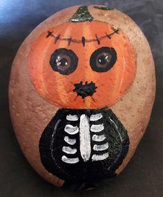 Pumpkin Head Skeleton Painted Rock, Collectible & Halloween Home Decor by MoonRocksArt on Etsy https://www.etsy.com/listing/555560997/pumpkin-head-skeleton-painted-rock
