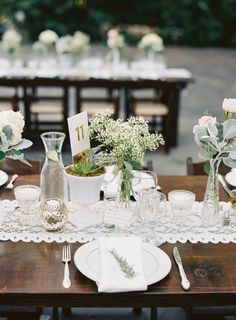 Vintage chic dinnerware and baby's breath table flowers: http://www.stylemepretty.com/california-weddings/grass-valley/2016/09/15/romantic-outdoor-state-park-wedding-in-california/ Photography: Graham Terhune - http://grahamterhune.com/